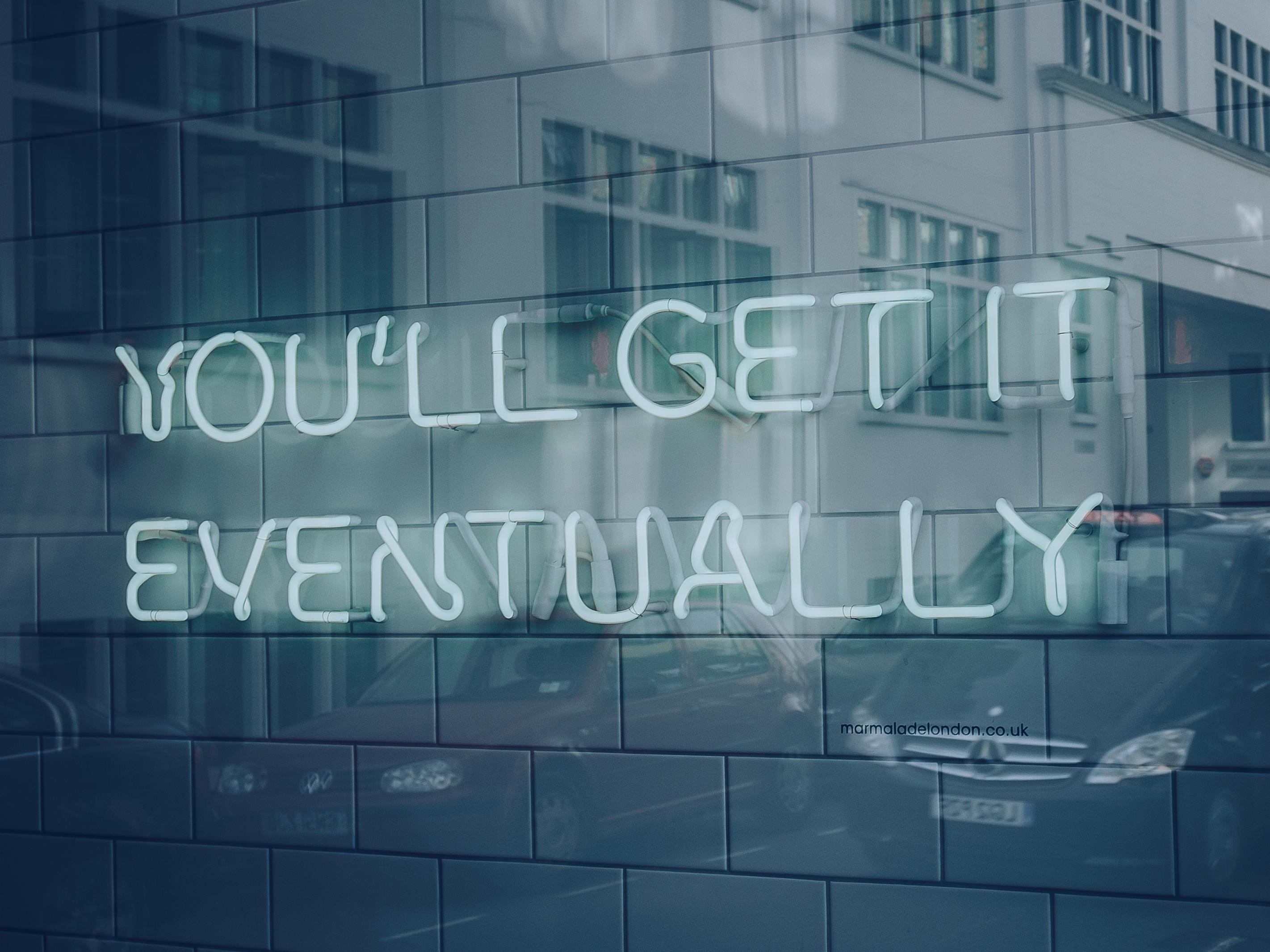 "neon sign ""you'll get it eventually"""